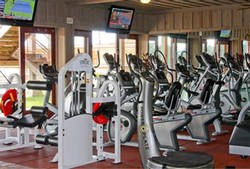 The fitness area is equipped with top of the line STRIVE strength training equipment and  multiple cardio machines. An open area to stretch or conduct floor exercises is also  available.